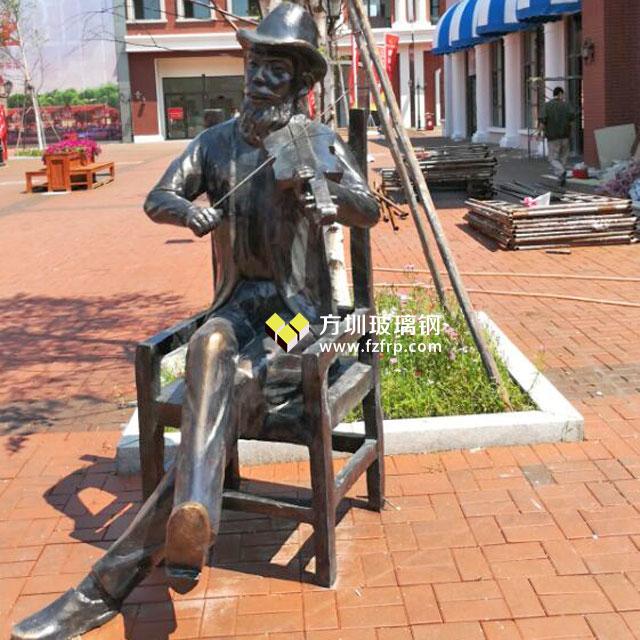 长春新华联开业庆典玻璃钢仿铜人物雕塑现场摆放图